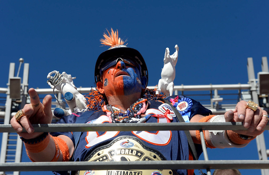 . Chuck DeVorss of Lakewood, CO watches the Broncos during the first half from the north stands. The Denver Broncos vs. The New England Patriots in an AFC Championship game  at Sports Authority Field at Mile High in Denver on January 19, 2014. (Photo by Craig Walker/The Denver Post)
