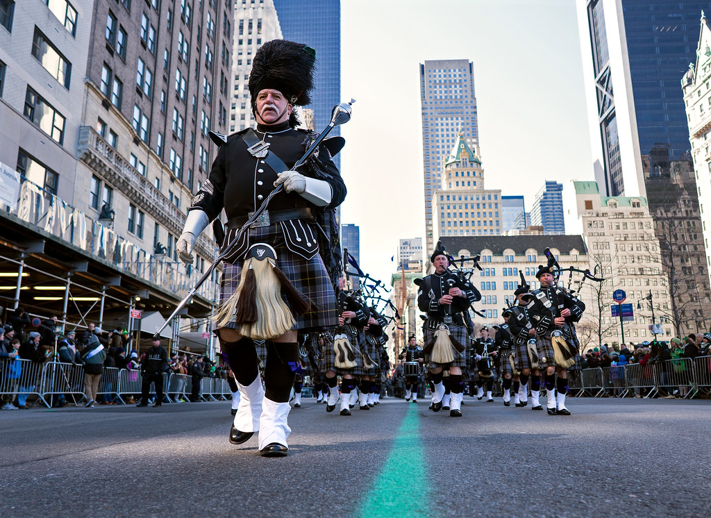 ". A bagpipe unit representing the New York State Police takes part in the St. Patrick\'s Day parade on Fifth Avenue Saturday, March 17, 2018, in New York.   Several bagpipe bands led a parade made up of over 100 marching bands after Democratic Gov. Andrew Cuomo spoke briefly, calling it a ""day of inclusion\"" and adding: \""We\'re all immigrants.\""  (AP Photo/Craig Ruttle)"