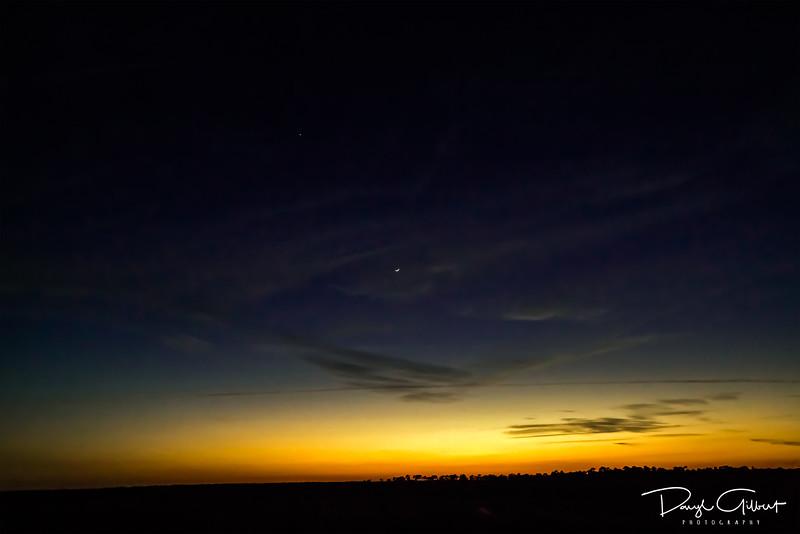Venus Looking Down on a Waxing Crescent Moon at Sunset