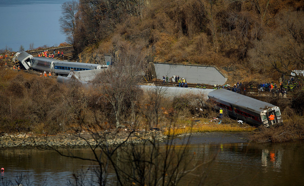 . First responders gather around the derailment of a Metro North passenger train in the Bronx borough of New York, Sunday, Dec. 1, 2013. (AP Photo/Craig Ruttle)