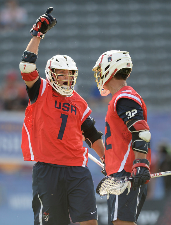 . COMMERCE CITY, CO - JULY 17: US attack Marcus Holman (1) celebrated a goal with Rob Panell (32) in the first half. Team USA faced Australia in a FIL World Championship semifinal game Thursday night, July 17, 2014.  Photo by Karl Gehring/The Denver Post