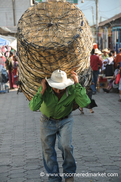Guatemalan Man Carrying Baskets - Santiago La Laguna, Guatemala