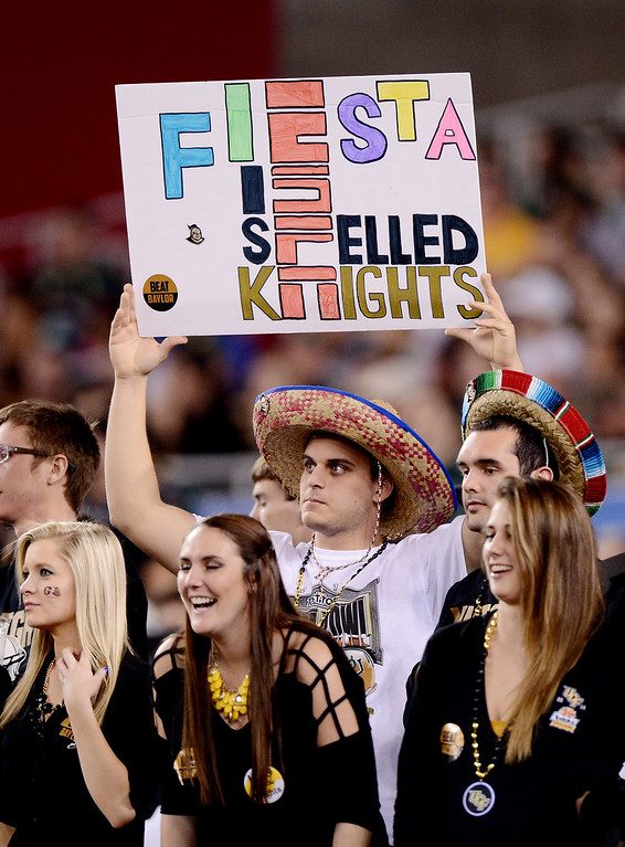 . GLENDALE, AZ - JANUARY 01:  A fan holds a sign during the Tostitos Fiesta Bowl between the Baylor Bears and the UCF Knights at University of Phoenix Stadium on January 1, 2014 in Glendale, Arizona.  (Photo by Jennifer Stewart/Getty Images)