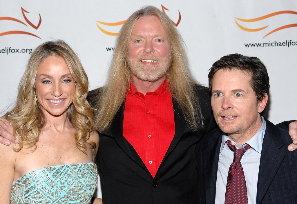 . From left, Tracy Pollan, Gregg Allman and Michael J Fox attend a \'A Funny Thing Happened on the Way to Cure Parkinson\'s\' benefit evening for The Michael J. Fox Foundation for Parkinson\'s Research on Saturday, Nov. 21, 2009 in New York. (AP Photo/Evan Agostini)