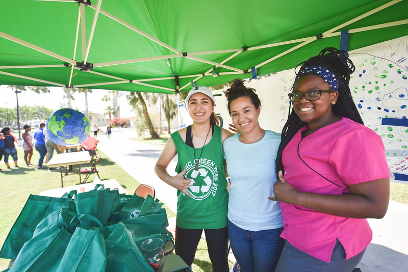 Megan Greige (left), Erica Ybarra, Ashley Cooper pause for a photo at their tent set up for SVC Green Week 2017 during the Islander Music Festival.