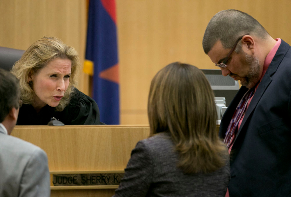 . Judge Sherry Stephens talks with prosecutor Juan Martinez, left, and defense attorney Jennifer Wilmott  and Kirk Nurmi during the Jodi Arias trial at Maricopa County Superior Court in Phoenix on Thursday, April 11, 2013.   Arias is on trial for the killing of her boyfriend, Travis Alexander, in 2008.  Arias faces a possible death sentence if convicted of first-degree murder.  (AP Photo/The Arizona Republic, David Wallace, Pool)