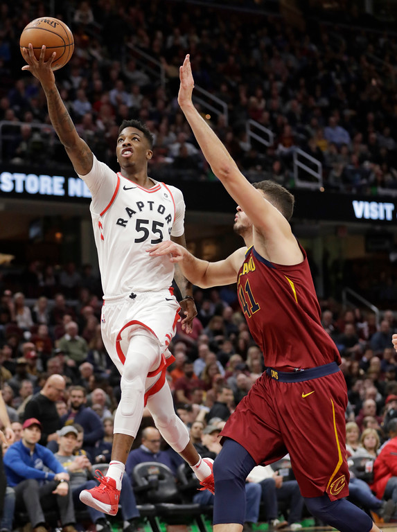 . Toronto Raptors\' Delon Wright (55) drives against Cleveland Cavaliers\' Ante Zizic (41) during the first half of an NBA basketball game Wednesday, March 21, 2018, in Cleveland. (AP Photo/Tony Dejak)