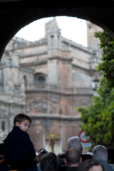 A child wating to see a Holy Week float on his father's shoulders, Seville, Spain