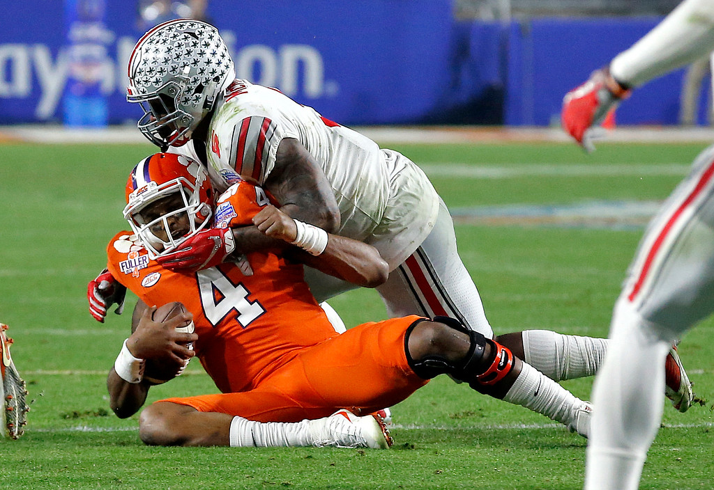 . Clemson quarterback Deshaun Watson (4) is sacked by Ohio State linebacker Raekwon McMillan (5) during the second half of the Fiesta Bowl NCAA college football game, Saturday, Dec. 31, 2016, in Glendale, Ariz. (AP Photo/Ross D. Franklin)