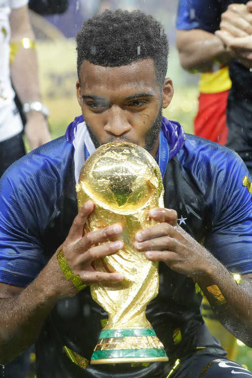 . France\'s Thomas Lemar kisses the trophy at the end of the final match between France and Croatia at the 2018 soccer World Cup in the Luzhniki Stadium in Moscow, Russia, Sunday, July 15, 2018. (AP Photo/Matthias Schrader)