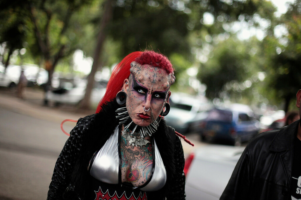 . Tattoo artist and former lawyer Maria Jose Cristerna, 36, from Guadalajara, Mexico, also called Vampire Woman, looks on upon her arrival at the Latin American Extreme Unity Fest 2012, in Guatemala City, September 22, 2012. 90 percent of Maria\'s body is tattooed and modified with subcutaneous implants.  REUTERS/Jorge Dan Lopez