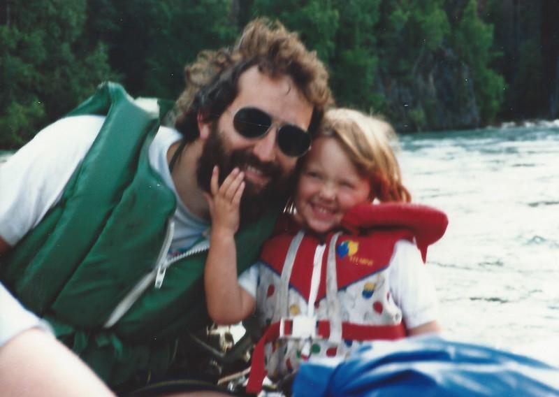 Devon and Dad rafting.jpeg