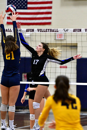 11/1/2018 Mike Orazzi | Staff Bristol Eastern's Gabriella Nozzolillo (17) and RHAM's Bella Johnson (21) during the CCC Volleyball Tournament at Avon High School Thursday night.