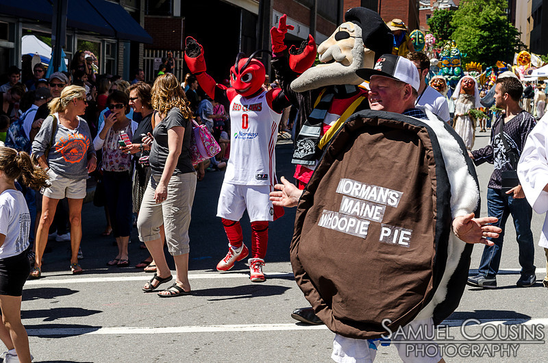 Norman's Maine Whoopie Pie mascot marching in the Old Port Festival parade.