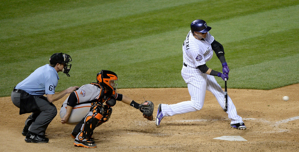 . Troy Tulowitzki (2) of the Colorado Rockies flies out to Gregor Blanco (7) of the San Francisco Giants during the seventh inning May 16, 2013 at Coors Field. (Photo By John Leyba/The Denver Post)