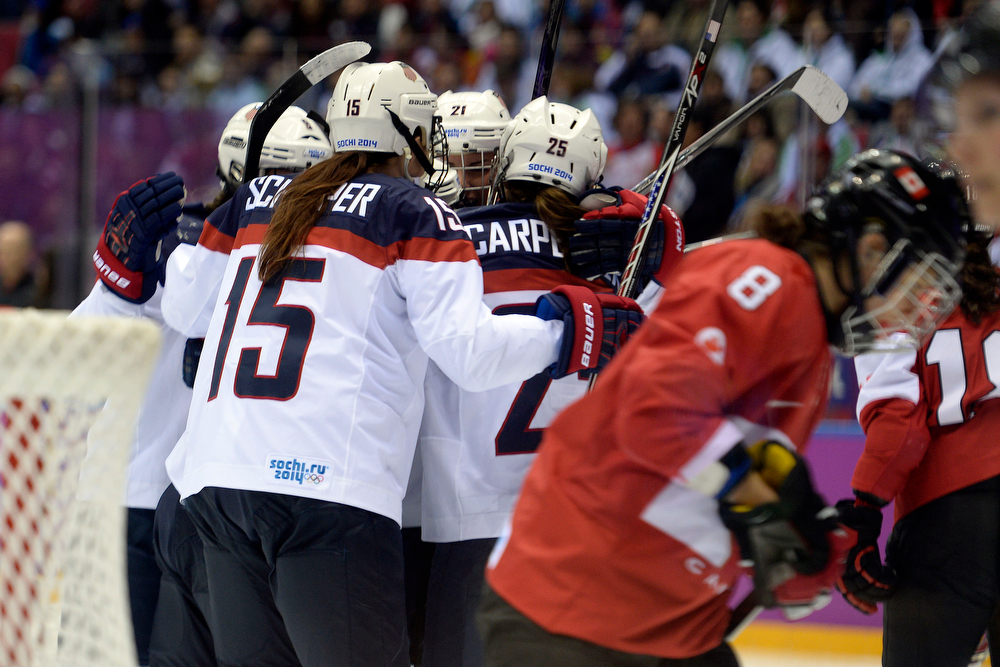 . Team U.S.A. celebrates a 2-0 goal by Alex Carpenter (25) against Canada during the third period of the women\'s gold medal ice hockey game. Sochi 2014 Winter Olympics on Thursday, February 20, 2014 at Bolshoy Ice Arena. (Photo by AAron Ontiveroz/ The Denver Post)