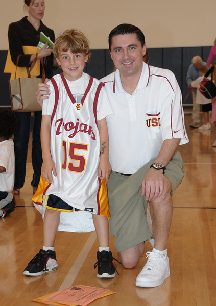 USC Assistant Coach Bob Cantu and Max (wearing the camp shootout grand prize)