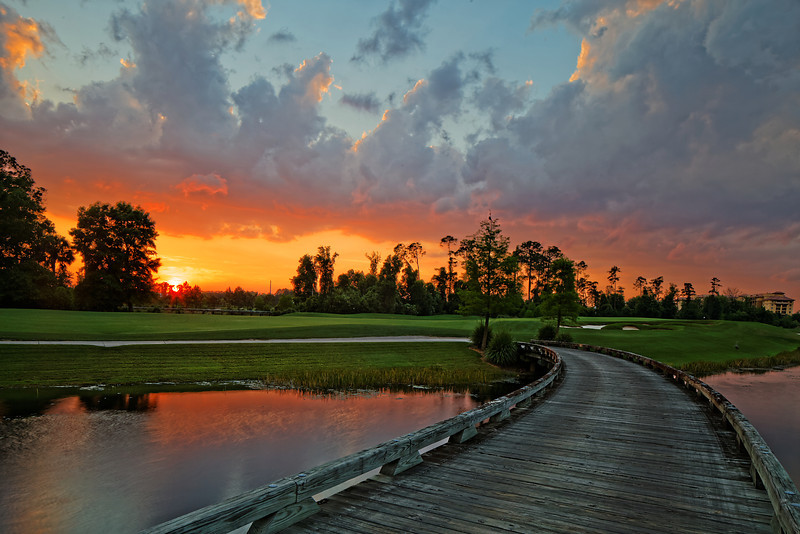 The sun sets over the golf course of the Waldorf Astoria Orlando