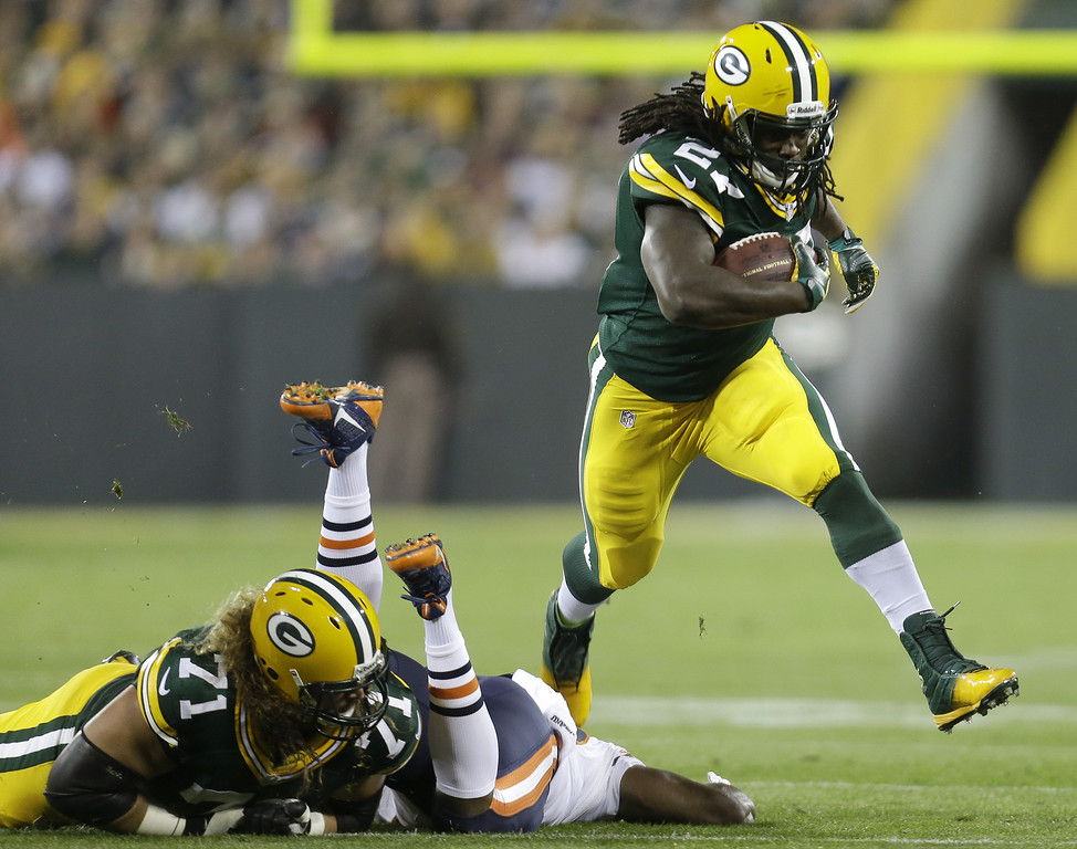 . Eddie Lacy #27 of the Green Bay Packers runs with the football during the first quarter of play against the Chicago Bears at Lambeau Field on November 04, 2013 in Green Bay, Wisconsin. (Photo by Mike McGinnis/Getty Images)