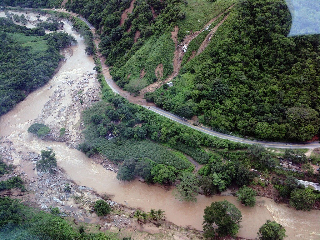 . This handout photo taken and released on September 18, 2013 by Mexico\'s Interior Ministry press office shows an aerial view of landslides along the highway going to Acapulco, in the Mexican state of Guerrero, as heavy rains hit the country. Resurgent Hurricane Manuel lashed Mexico\'s northwest coast early on September 19 after twin storms killed at least 80 people nationwide and buried a village under a massive mudslide, leaving dozens more missing. The storms damaged bridges, caused rivers to overflow and flooded half of the Pacific resort of Acapulco, stranding tens of thousands of tourists who sought airlifts while looters ransacked stores.      AFP PHOTO/ Interior MINISTRY /AFP/Getty Images