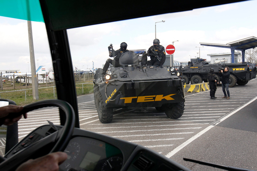 . Counter Terrorism Centre (TEK) personnel arrive with an APC vehicle at the parking facility of the Liszt Ferenc International Airport in Budapest, Hungary, Tuesday, March 22, 2016. Hungary raised its terrorism awareness level to grade 2 after a series of attacks in Brussels. (Zsolt Szigetvary/MTI via AP)