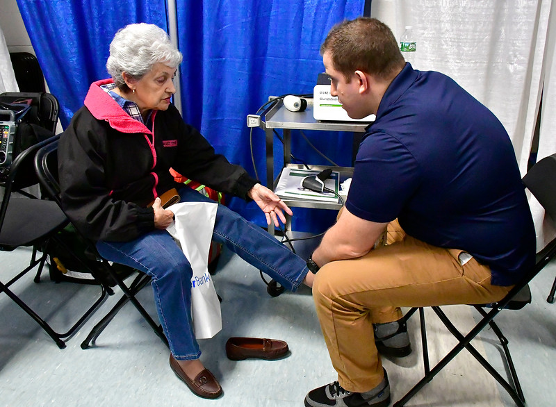 2/16/2019 Mike Orazzi | Staff Bristol Hospital foot and ankle surgeon Peter Bellezza talks with Simone Dallaire during the 34th annual Bristol Home & Business Show at Bristol Eastern High School on Saturday.