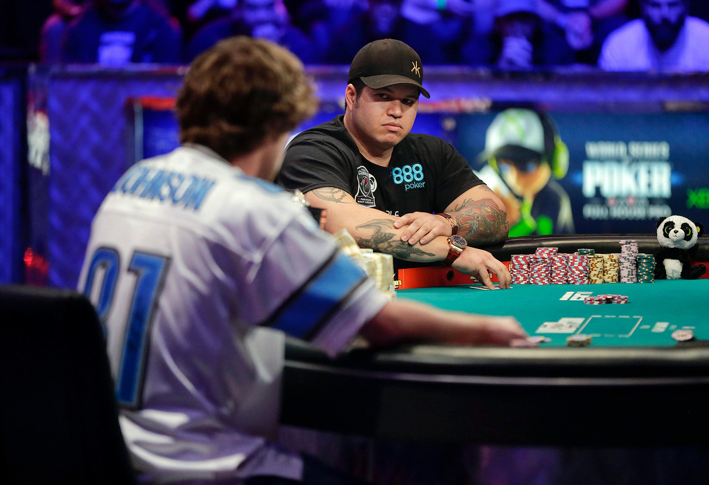 . Jay Farber, right, waits for Ryan Riess\' decision to call or fold during the World Series of Poker final table, Tuesday, Nov. 5, 2013, in Las Vegas. (AP Photo/Julie Jacobson)