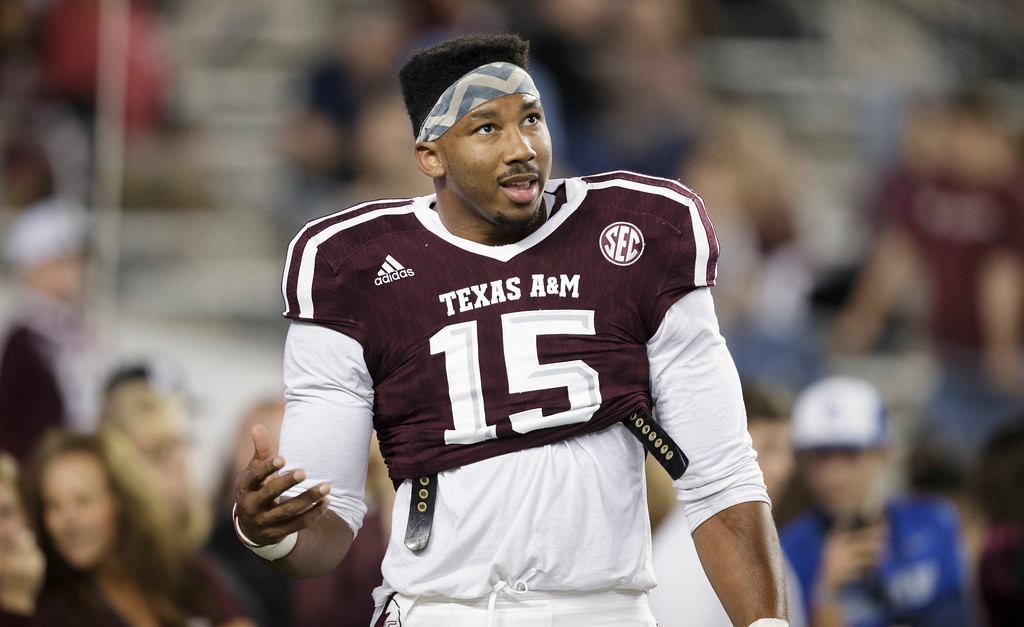 . Texas A&M defensive lineman Myles Garrett (15) talks to teammates in between drills before the start of an NCAA college football game against Ole Miss Saturday, Nov. 12, 2016, in College Station, Texas. (AP Photo/Sam Craft)