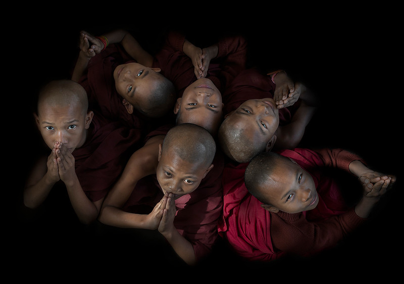 A group of young monks having fun with the camera.