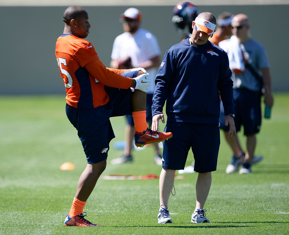 . Denver Broncos Chris Harris Jr. (25) runs through some conditioning with Anthony Lomando Asst. Strength coach during OTAs  June 2, 2014 at Dove Valley. (Photo by John Leyba/The Denver Post)