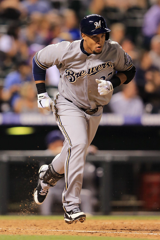 . DENVER, CO - JULY 26:  Carlos Gomez #27 of the Milwaukee Brewers rounds the bases on his solo home run off of Manny Corpas #60 of the Colorado Rockies in the ninth inning at Coors Field on July 26, 2013 in Denver, Colorado.  (Photo by Doug Pensinger/Getty Images)