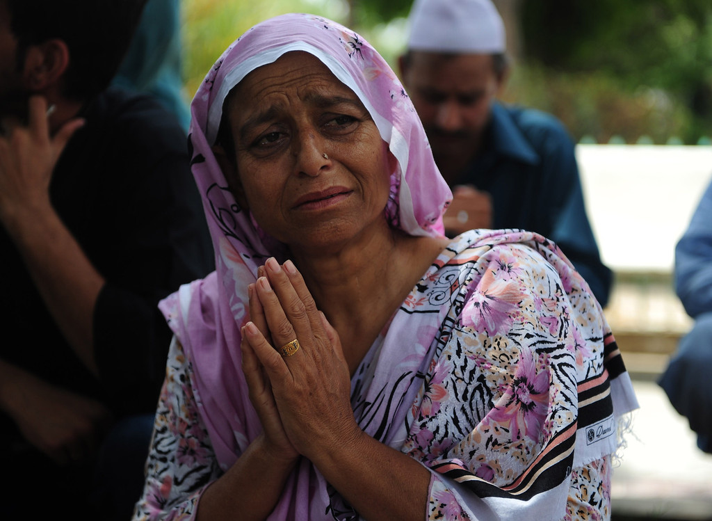 . Pakistani relatives mourn missing family members following an assault by militants at Karachi airport terminal in Karachi on June 9, 2014.  AFP PHOTO/Rizwan  TABASSUM/AFP/Getty Images