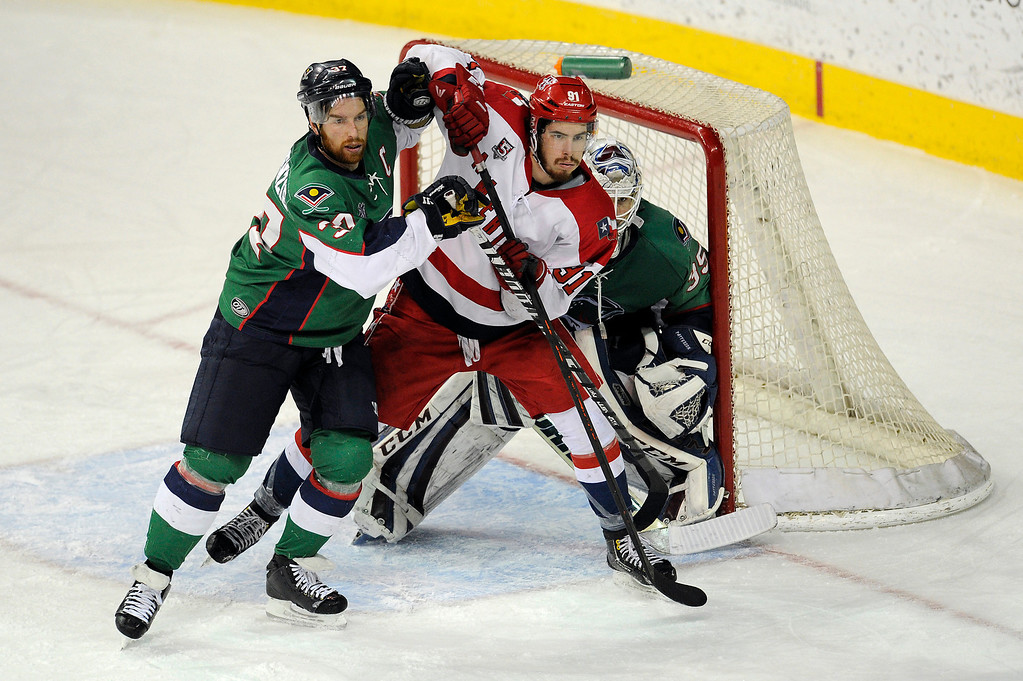 . DENVER, CO - MAY 2: Aaron MacKenzie (37) of the Denver Cutthroats and Jonathan Lessard (91) of the Allen Americans tussle in front of the net during the second period of game 1 of the Ray Miron Presidents Cup Finals at the Denver Coliseum in Denver, Colorado on May 2, 2014. (Photo by Seth McConnell/The Denver Post)