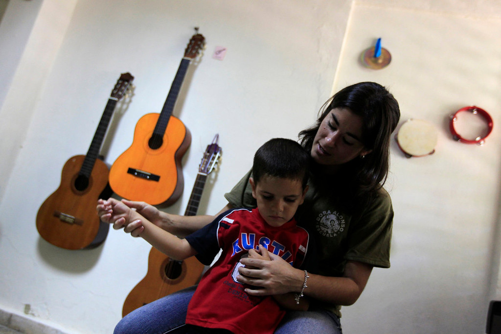 . An autistic child attends a music class at the Dora Alonso School in Havana April 29, 2013. The Dora Alonso School is a school specializing in treating children who suffer from autism spectrum disorders. The building housing the school was a military facility before the 1959 Cuban Revolution, and was inaugurated as a school for children with special needs ten years ago by Cuba\'s former President Fidel Castro.  REUTERS/Enrique De La Osa