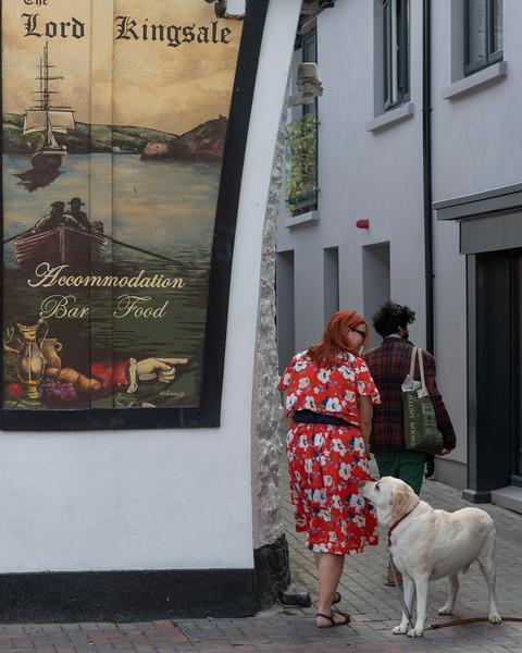 Couple walking with a dog, Kinsale, County Cork, Ireland