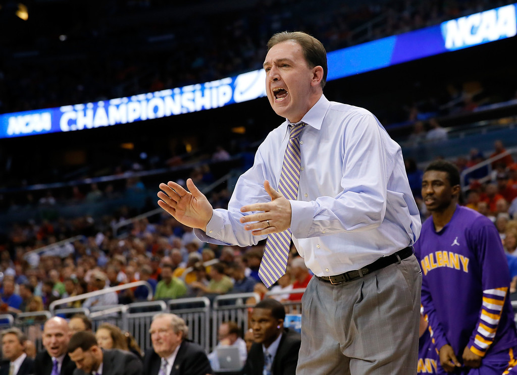 . ORLANDO, FL - MARCH 20:  Head coach Will Brown of the Albany Great Danes calls out in the first half while taking on the Albany Great Danes during the second round of the 2014 NCAA Men\'s Basketball Tournament at Amway Center on March 20, 2014 in Orlando, Florida.  (Photo by Kevin C. Cox/Getty Images)