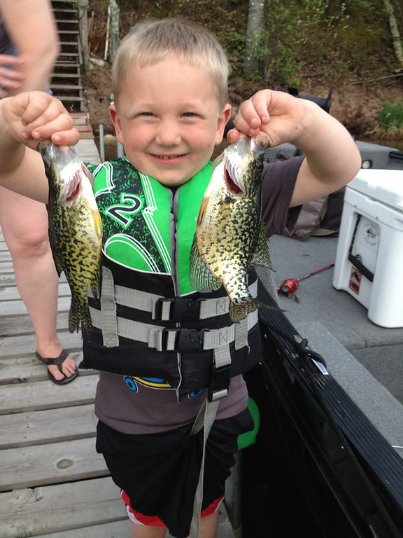 ". Mason Gonzalez, 3, of Cottage Grove, hooked these crappies -- his first -- May 25 in Minong, Wis. He reported the bites to his father, announcing, ""My bobber is dancing, dad!\"" (Photo courtesy Matt Gonzalez)"