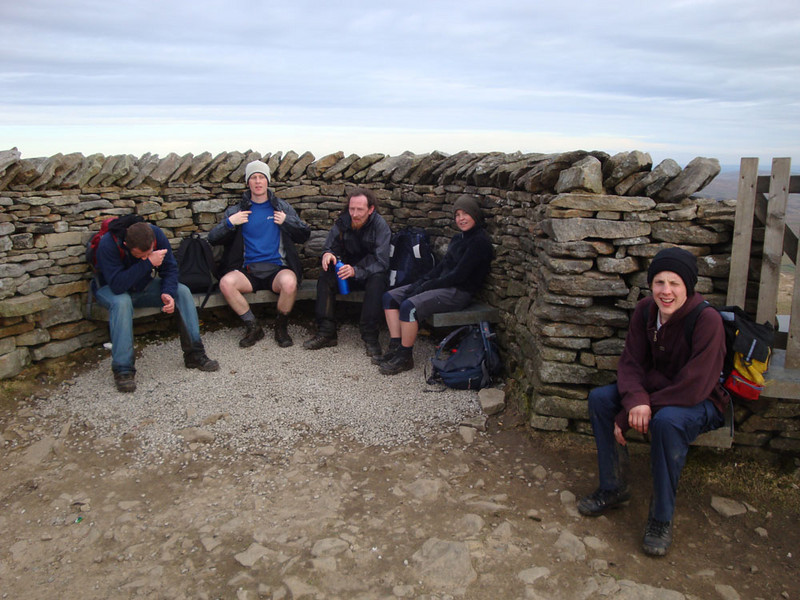 Peak 3: Pen-y-Ghent. Sheltering from yet more freezing wind. Seriously knackered after about 10 hours, but this is the very last summit!