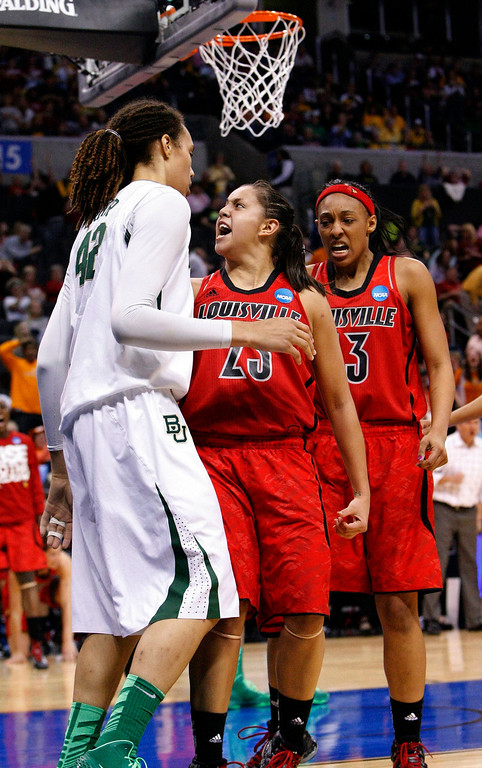 . Louisville\'s guard Shoni Schimmel, center, reacts to her shot over Baylor\'s Brittney Griner, left, as Louisville\'s Sheronne Vails, right, stands by during the second half of a regional semifinal in the women\'s NCAA college basketball tournament in Oklahoma City, Sunday, March 31, 2013. Louisville won 82-81. (AP Photo/Alonzo Adams)