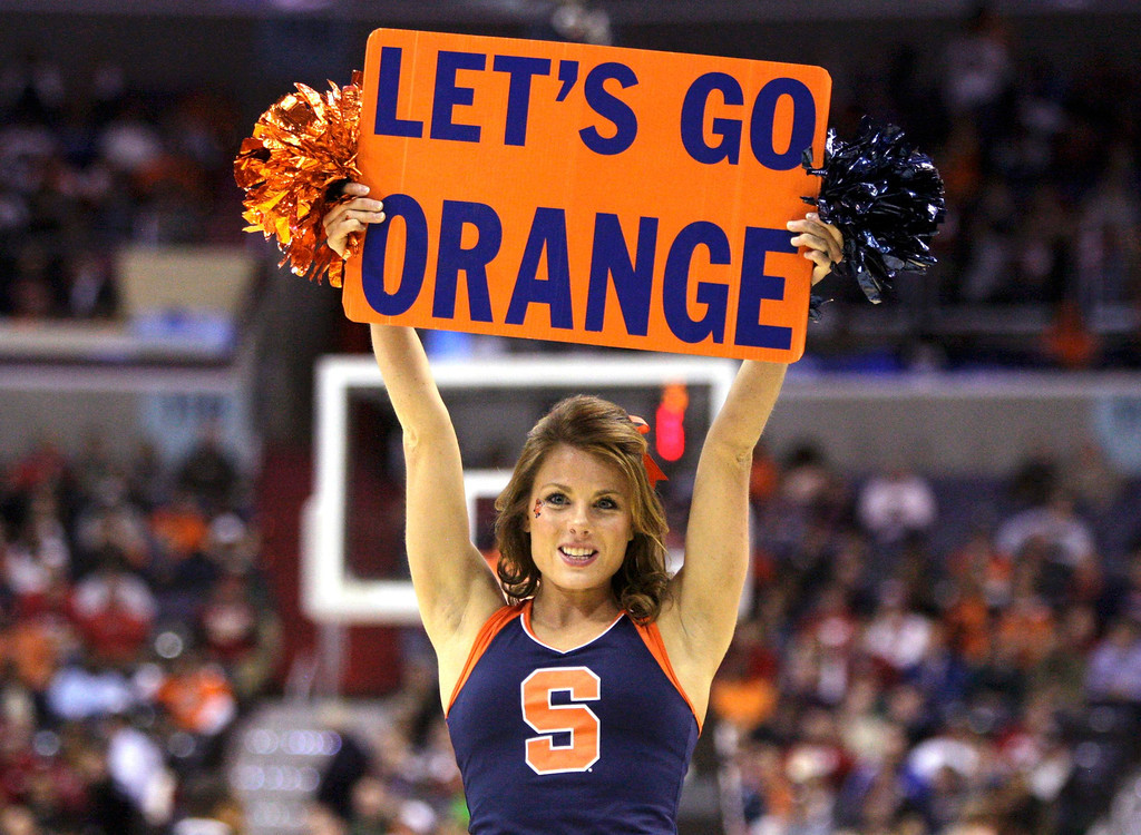 . A Syracuse Orange cheerleader performs during the second half in their East Regional NCAA men\'s basketball game against the Indiana Hoosiers in Washington, March 28, 2013.  REUTERS/Jonathan Ernst