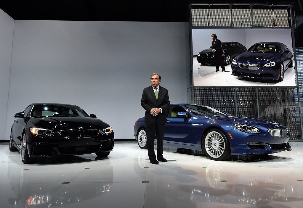 . CEO of BMW North America Ludwig Willisch with the 2015 BMW X4 which was unveiled during the first press preview day at the 2014 New York International Auto Show  April 16, 2014  at the Jacob Javits Center in New York. The auto show is open to the public April 18-27. AFP PHOTO / Timothy A. Clary/AFP/Getty Images