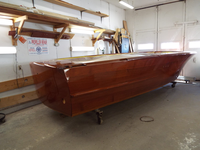 Starboard view with the boat out of the finish room. We now have ten coats of build up finish applied. We will let this dry then wet sand to block out the hull. then back to the finish room for more finish.