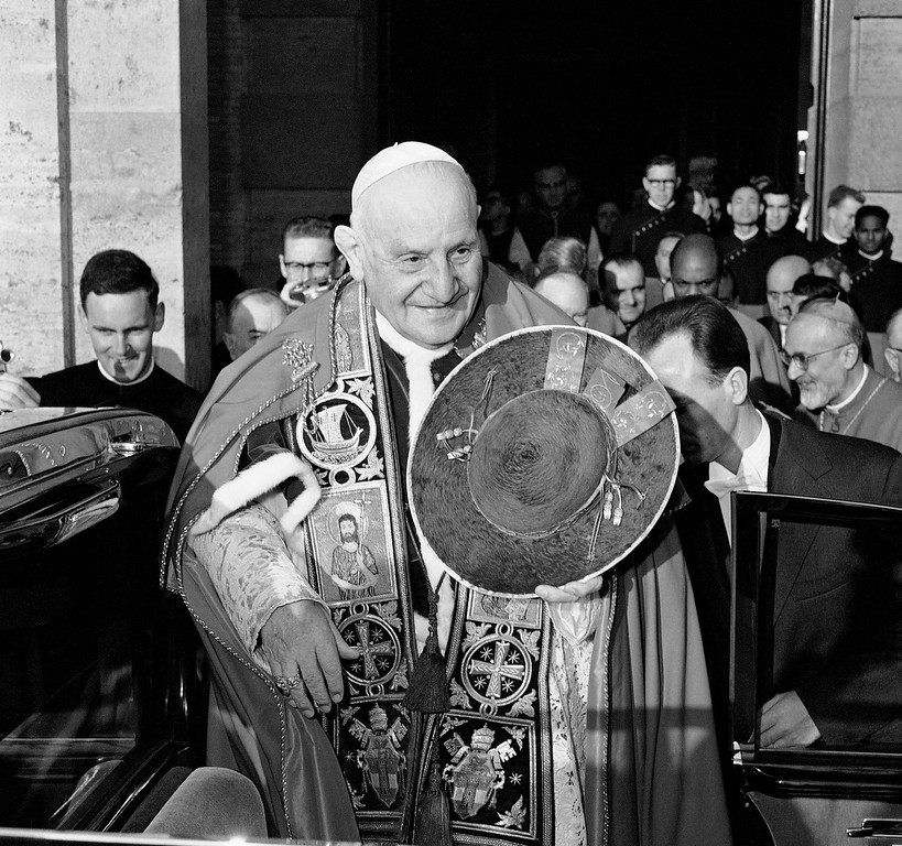 . 1962: Pope John XXIII. Pope John XXIII, in his papal robes and holding his hat, stands outside Pontifical College for the Propagation of the Faith in Rome, after celebrating Mass on his 81st birthday, Nov. 25, 1962. (AP Photo)