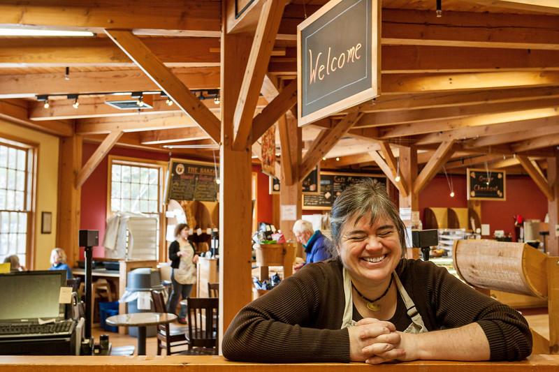 Ellen Kitchel greets visitors to King Arthur Flour's cafe and store in Norwich, Vermont
