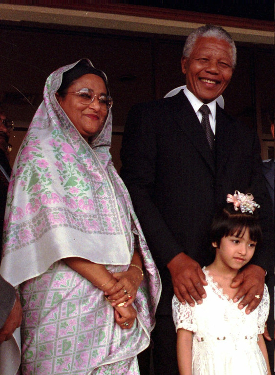 . President Nelson Mandela of South Africa , right, and Bangladesh Prime Pinister Sheikh Hasina pose for photographs at Dhaka airport after Mandela\'s arrival on Tuesday, March 25, 1997. Mandela will attend Bnagladesh\'s silver jublee celebration for their independence on Wednesday. Sheikh Rupomti, 5, daughter of premier\'s younger sister Shiekh Rehana stands with leaders. (AP Photo/Pavel Rahman)
