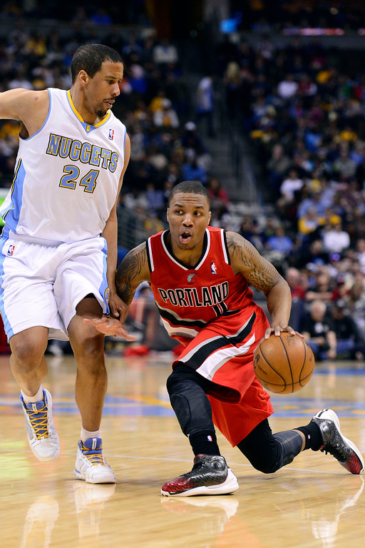 . DENVER, CO - APRIL 14: Damian Lillard (0) of the Portland Trail Blazers drives on Andre Miller (24) of the Denver Nuggets during the second half of action. The Denver Nuggets defeat the Portland Trail Blazers 118-109 at the Pepsi Center. (Photo by AAron Ontiveroz/The Denver Post)