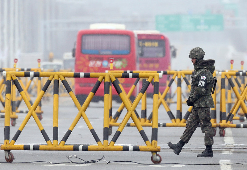 ". A South Korean soldier stands guard at a military check point in Paju near the demilitarized zone dividing the two Koreas on February 12, 2013. North Korea on February 12 staged its most powerful nuclear test yet, claiming a breakthrough with a ""miniaturised\"" device in a striking act of defiance that drew condemnation from global powers including its sole patron China. AFP PHOTO/DONG-A ILBODONG-A ILBO/AFP/Getty Images"