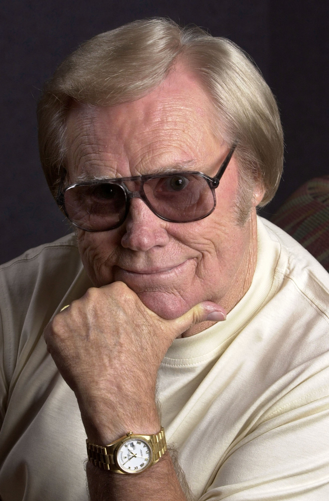 . Country music legend George Jones poses in Nashville, Tenn., Sept. 4, 2001. Jones, who turns 70-years-old Sept. 12, has a new album titled \'The Rock: Stone Cold Country 2001,\' due on Sept. 25, containing a duet with Garth Brooks called \'Beer Run.\' Besides his touring schedule, Jones\' catalog of country music classics is being featured four times a week in Nashville, at a musical celebrating the life of his late ex-wife Tammy Wynette. (AP Photo/Mark Humphrey)