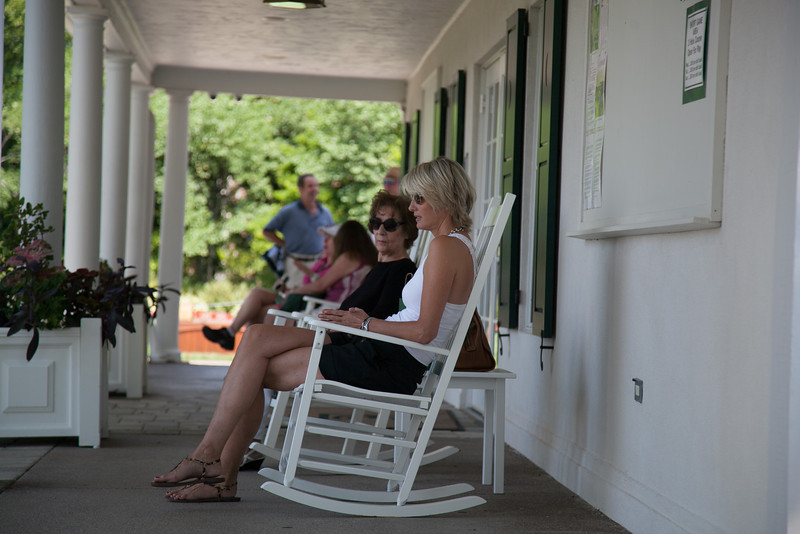 Spectators watch the action from rocking chairs in front of the pro shop during first round medal play at the 2012 Western Amateur Championship at Exmoor Country Club in Highland Park IL. on Tuesday, July 31, 2012. (WGA Photo/Charles Cherney)