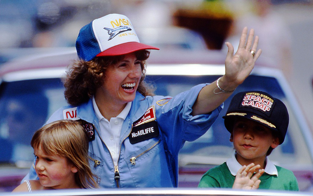 . In this 1985 photo, high school teacher Christa McAuliffe rides with her children Caroline, left, and Scott during a parade down Main Street in Concord, N.H. McAuliffe was one of seven crew members killed in the Space Shuttle Challenger explosion on Jan. 28, 1986. (AP Photo/Jim Cole)